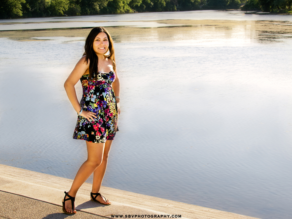 A high school senior in Northwest indiana takes photos with a gorgeous water backdrop.