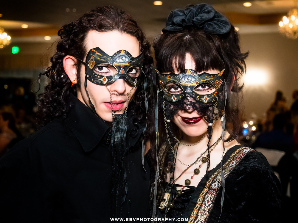 A couple dresses up in exotic masks to attend a Masquerade Ball in Schererville, Indiana.