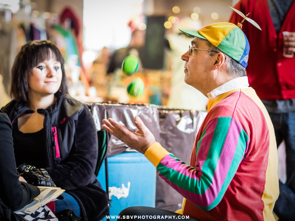 A juggler performs for participants at the Hunt and Gather Pop Up Market in Crown Point, Indiana.