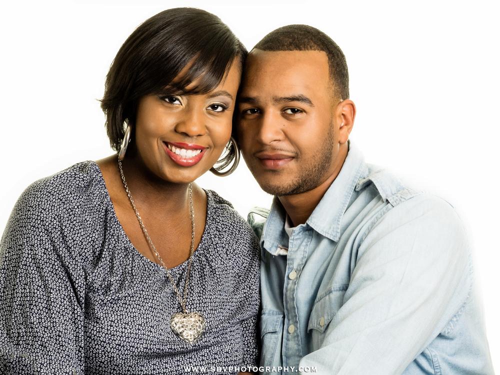 Studio portrait of newly engaged couple.