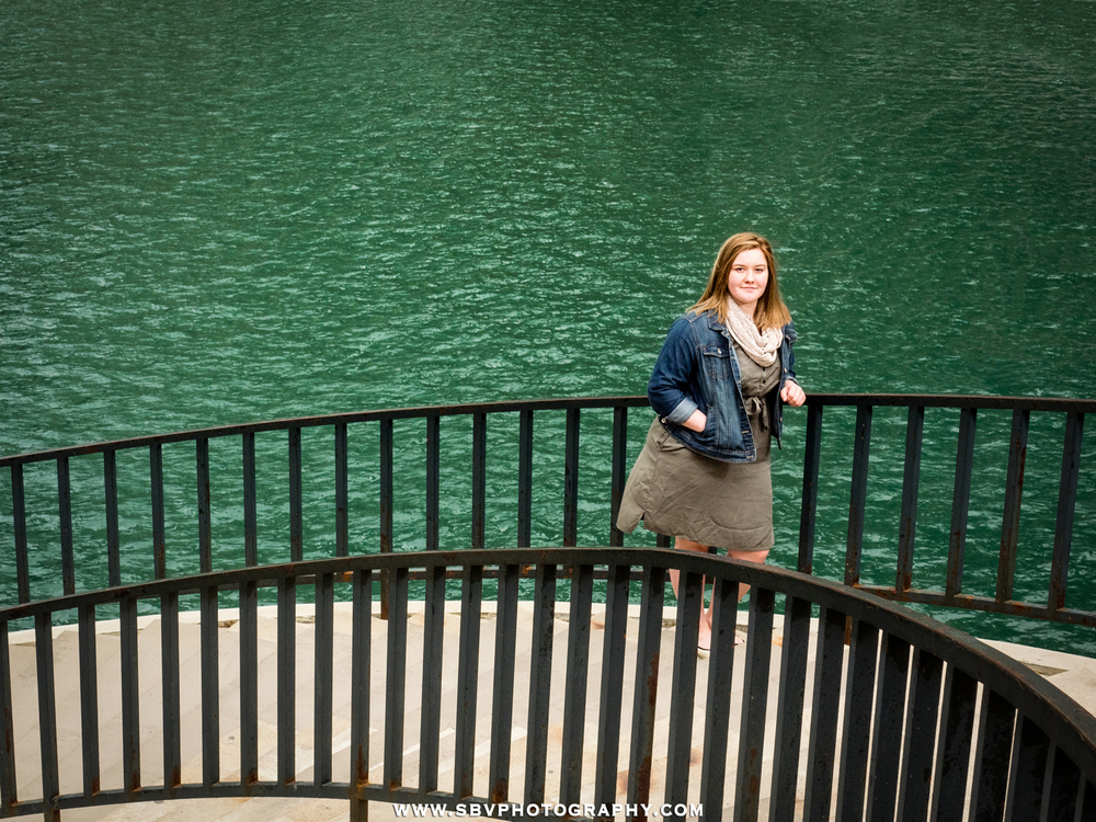 The Chicago river is a deep green in this high school senior photo.