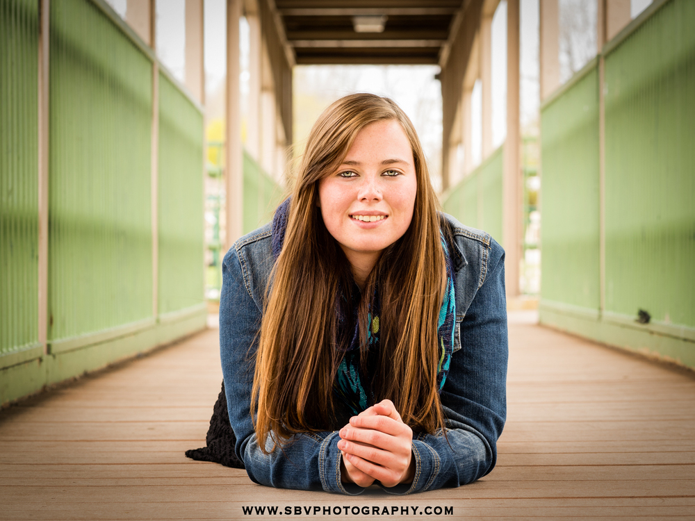 Senior girl poses on the bridge over Lake George in downtown Hobart.
