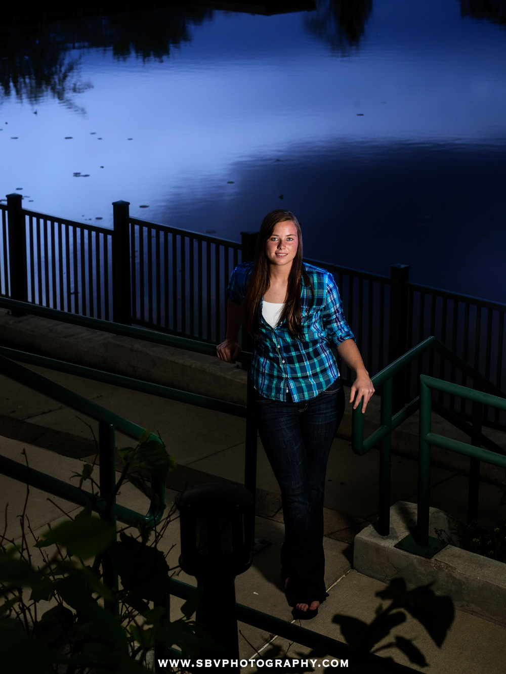 High school senior girl overlooking Lake George in the evening hours.
