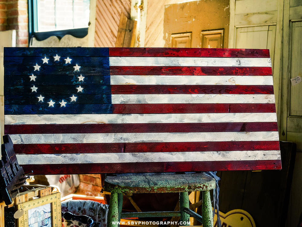 Vintage American Flag on wood display.