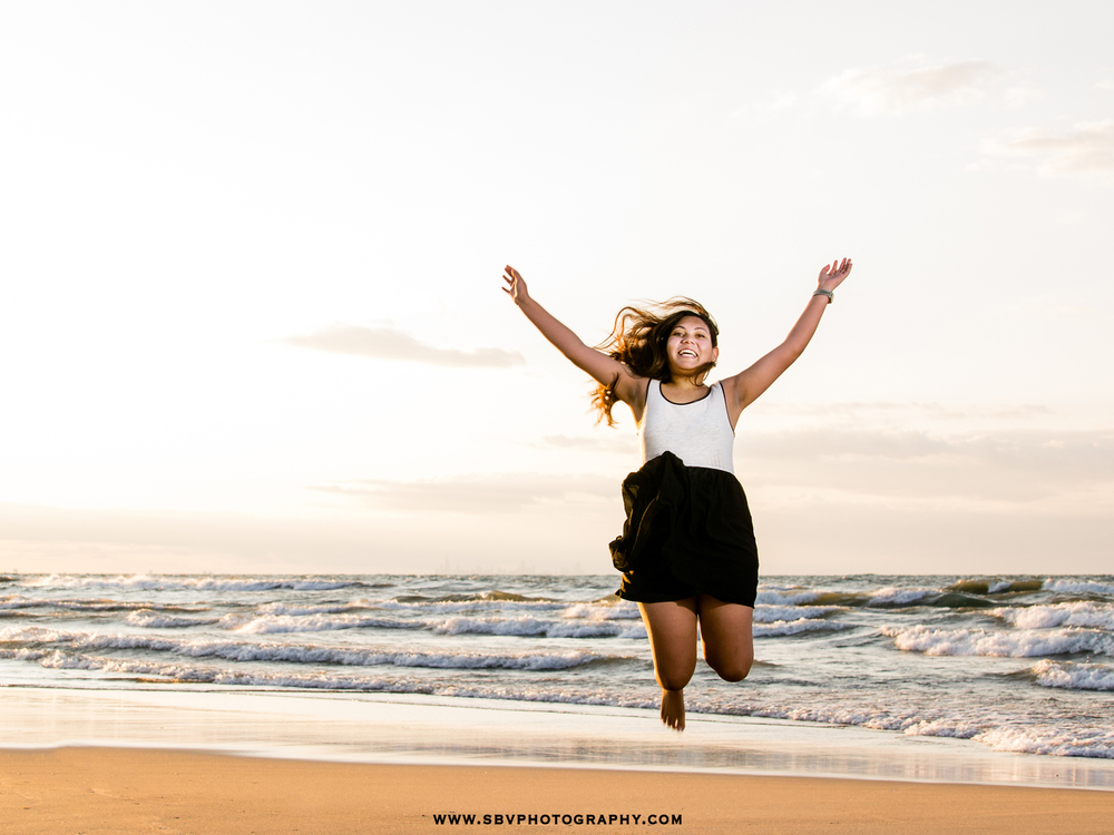 jumping-senior-girl-beach.jpg