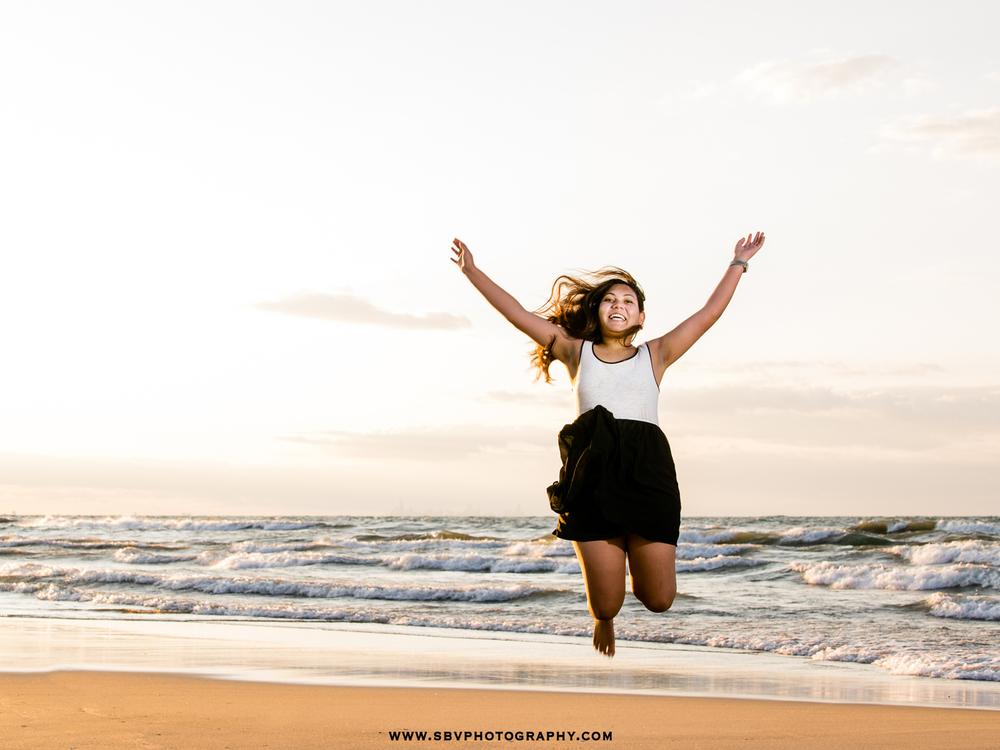 jumping-senior-girl-beach.jpg
