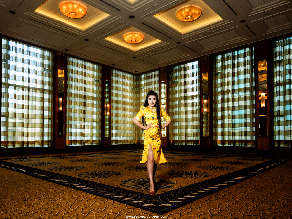 A Chicago business woman shows off her lovely dress inside the ballroom of The Peninsula Chicago.