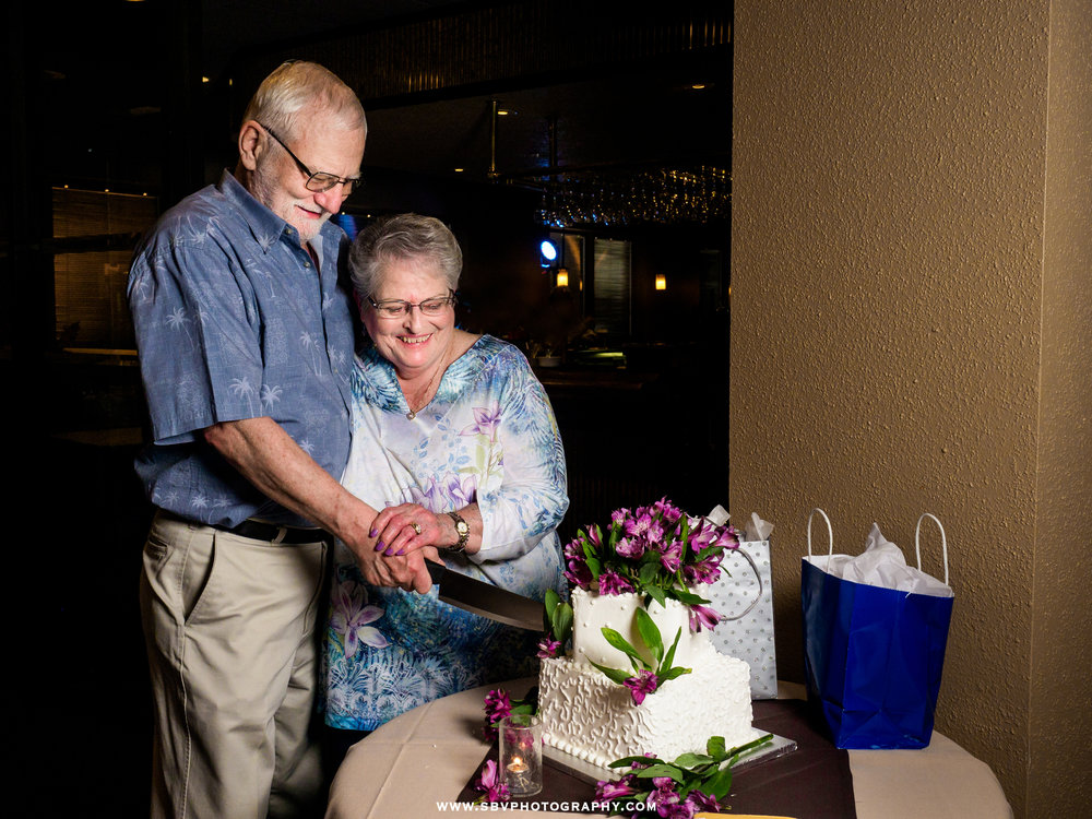 older-couple-cuts-cake.jpg