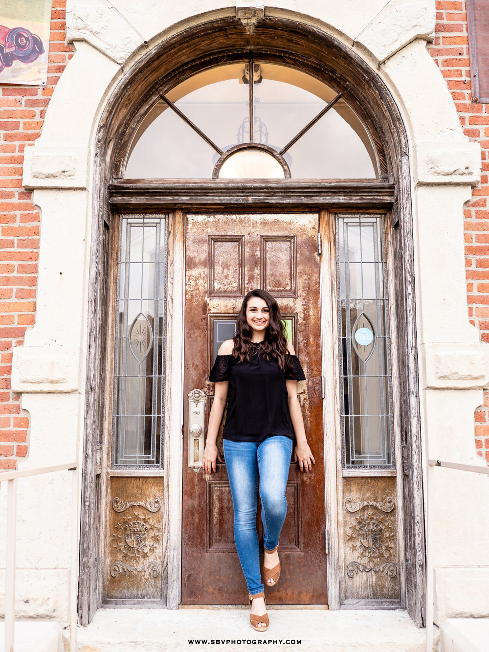 Senior photo at the entrance of the Porter County Museum.