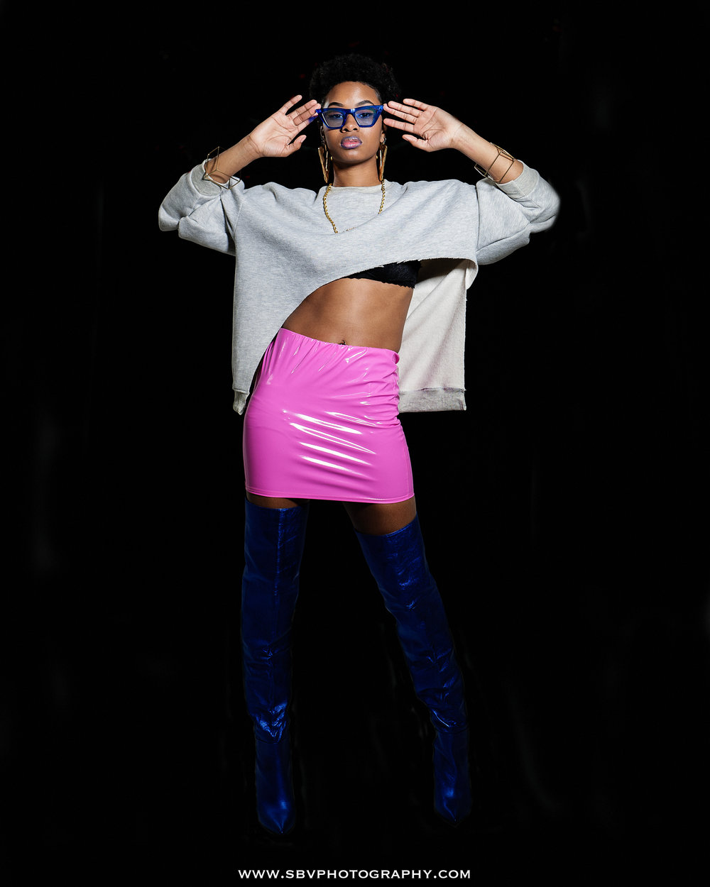 A modeling portfolio session with Emoni B. in a pink latex skirt.