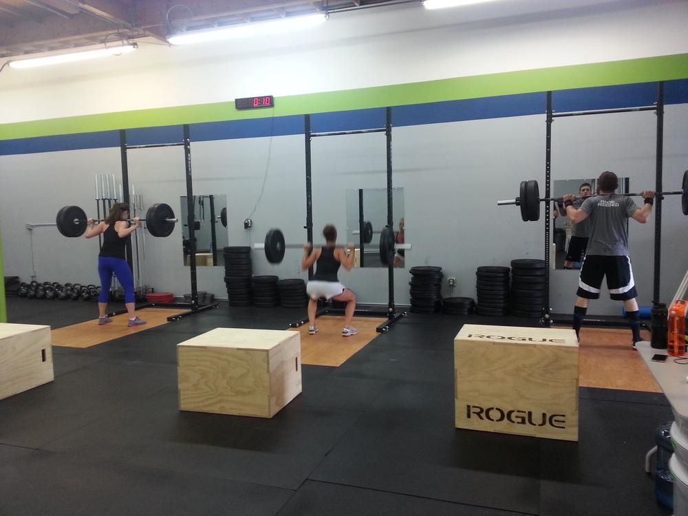 Tara, Toni, and Lance loving the squats!