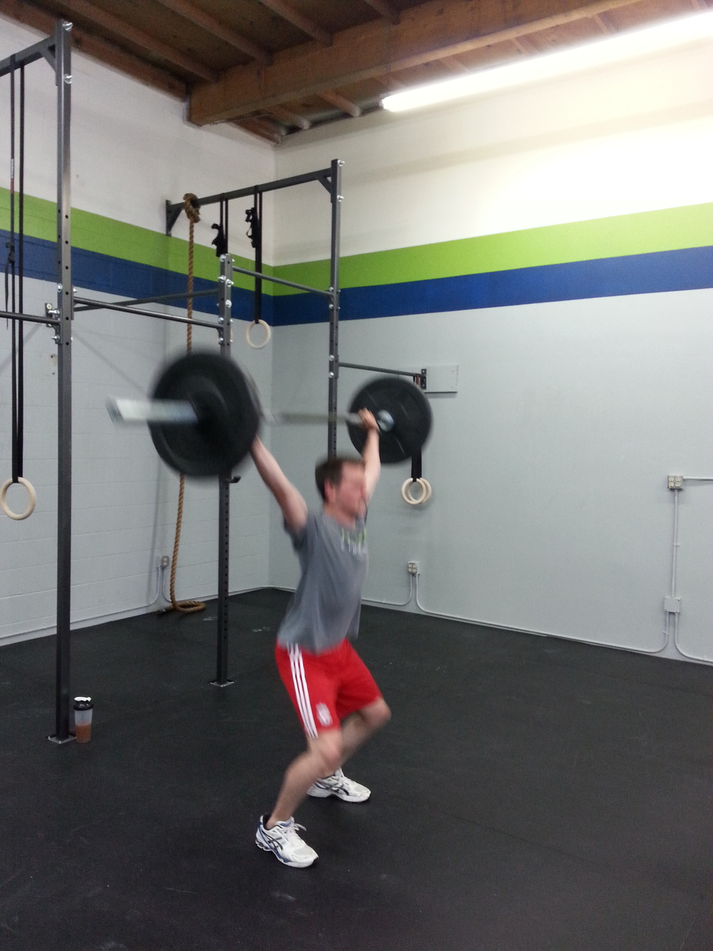 Bryan's moving so fast on those snatches that I can't even focus on my camera.