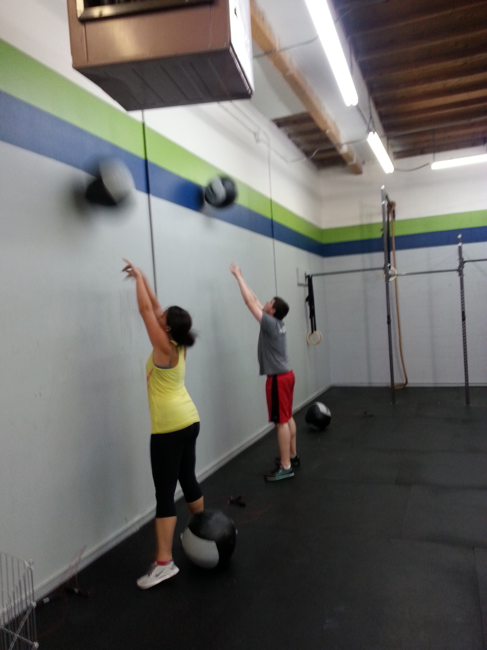 Ivy and Phil tossing up their wall balls at our 6pm class!