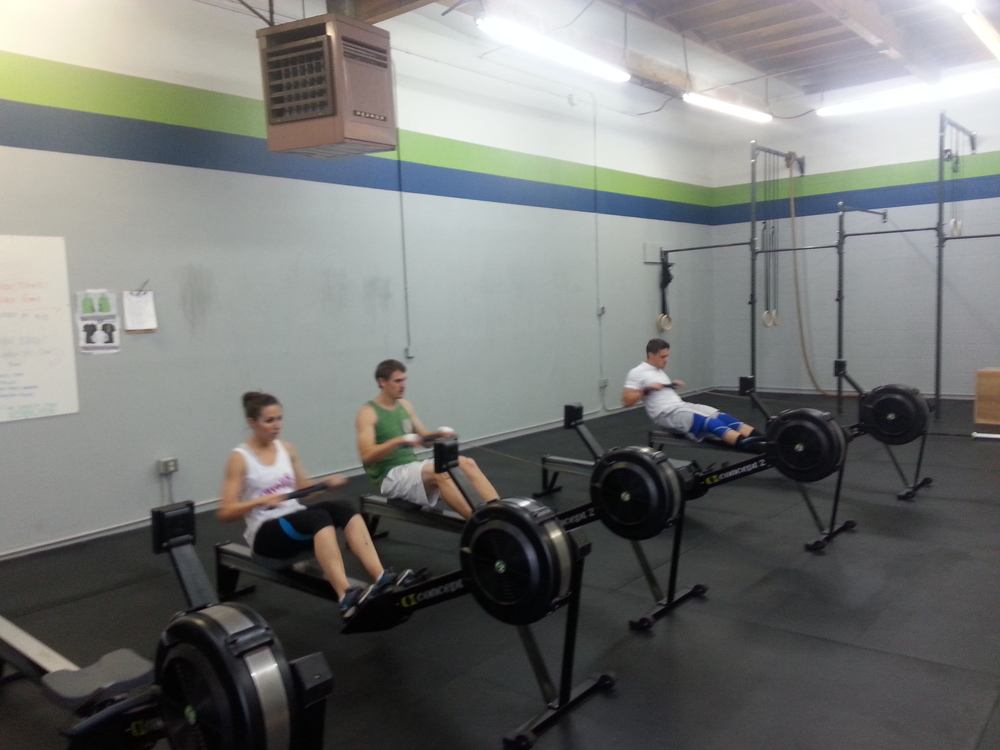 4:30pm class pulling hard on their 1000m row.