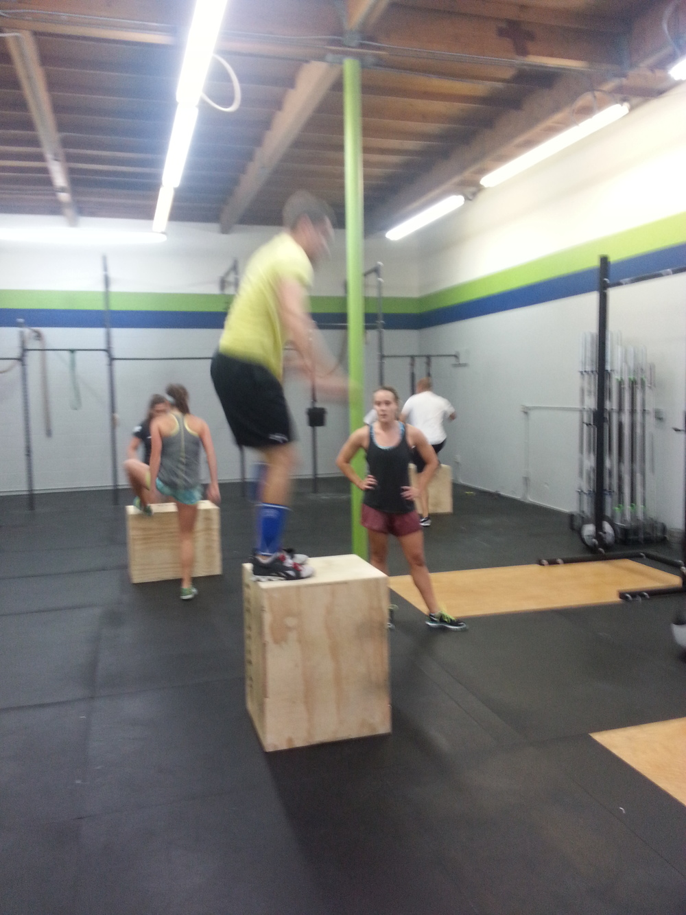 8:30am Class having a good ole time through the partner WOD!