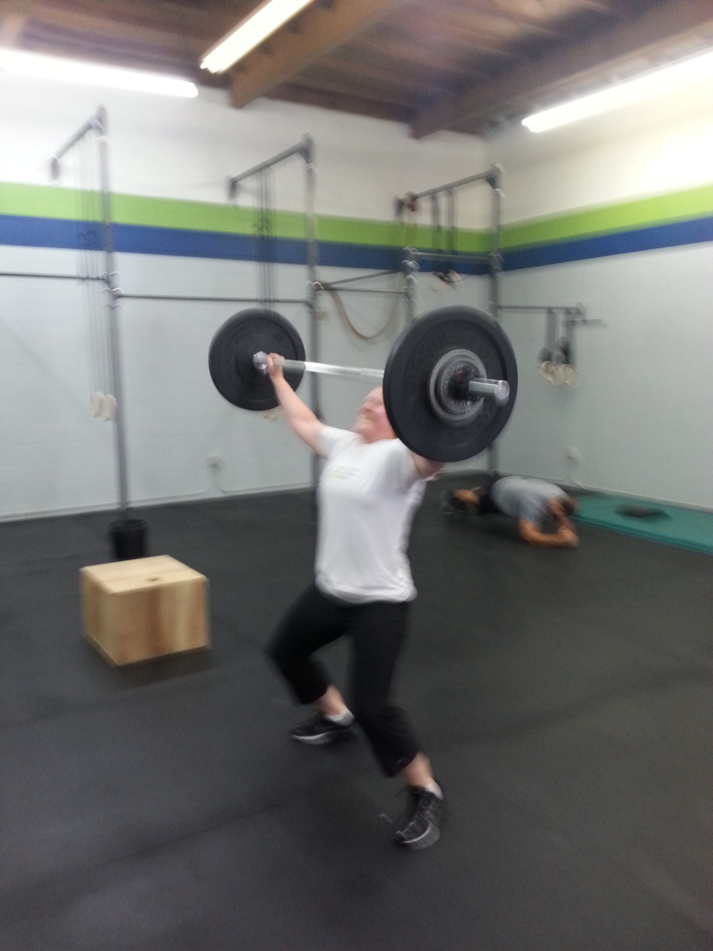 Jenny mid-snatch through the WOD!