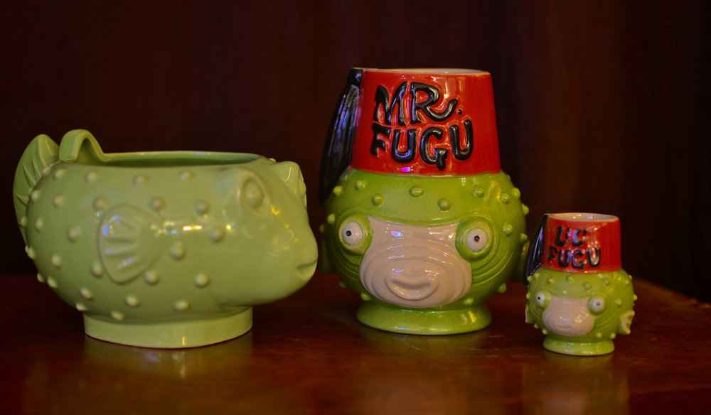 Some of Tiki Farm's fugu mugs.