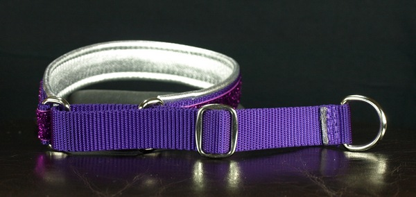 The first of our martingale style collars is the  Keeper Style . It uses the same tug design as the Keeper Hidden Prong collar with a sliding metal double ring that allows you to change how far the martingale can loosen. Martingale collars come with or without a plastic snap buckle. If you order a collar without a snap buckle, be sure that it will be able to slide over the widest part of the dog's head.