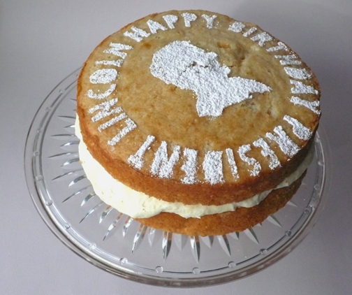 Cake: Lincoln's favorite cake, with oomph. Two layers of White Almond Cake with a filling of Lemon Mousse. On top is powdered sugar dusted on through a hand-cut stencil.