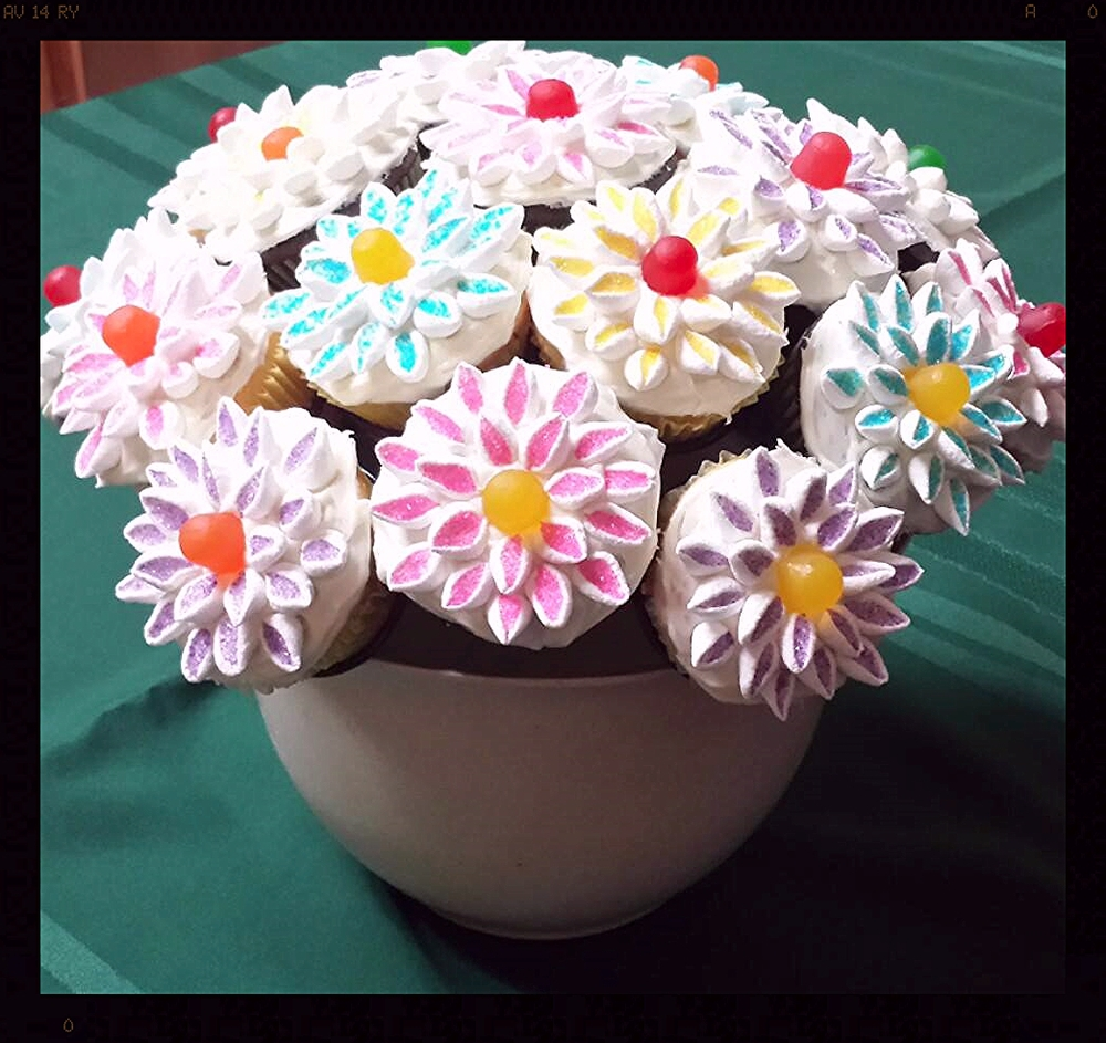 Jenny created this adorable cupcake bouquet using mini mallows! Cut the mallows diagonally and drop into colored sugar. The sugar adheres to the cut part of the mallow.  CUTE!