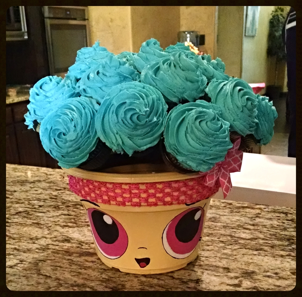 Jaime N. made this adorable ShopKins cupcake bouquet by painting the flower pot that came with her order. What fun with her grandkids! I think I'll try this with my own grandkids!