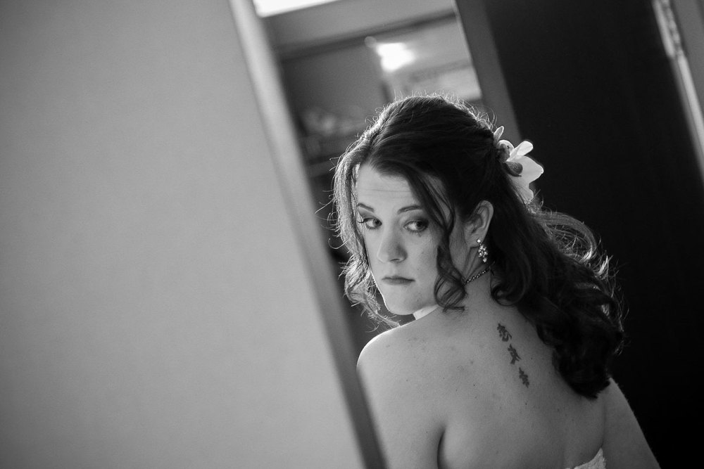 Bride gets ready before her wedding at the Catalyst Ranch.