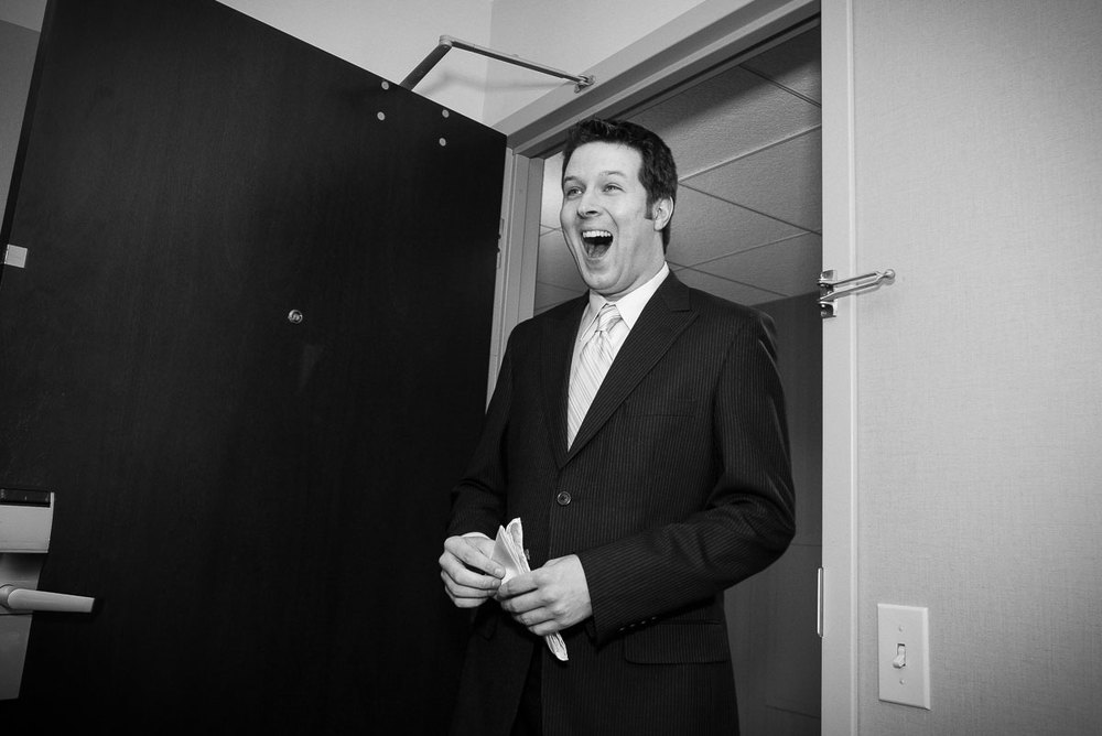 Groom reacts to seeing his bride at the Crown Plaza Chicago.