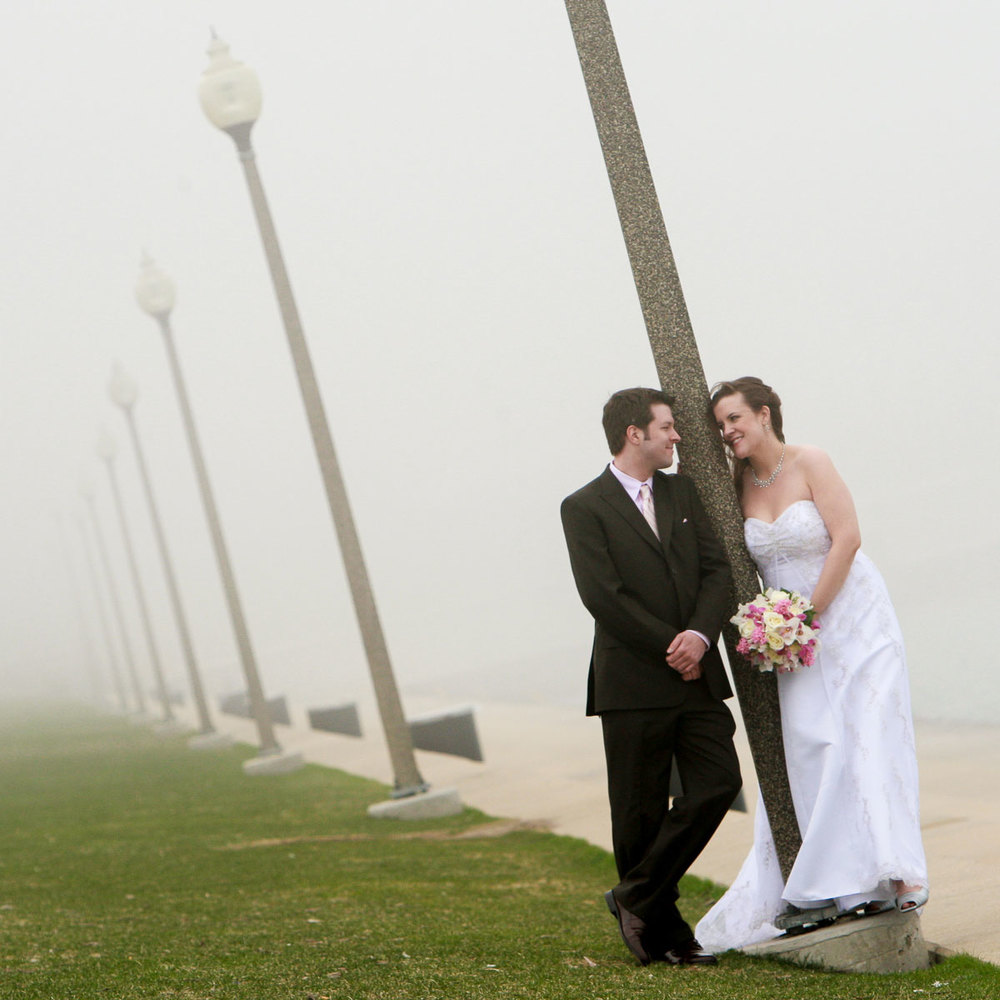 Foggy portrait of bride & groom on Lake Michigan near the Planetarium.