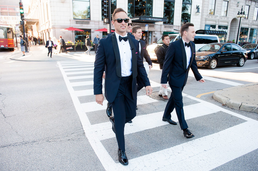 Groom crosses Michigan Avenue before the first look in Grant Park.