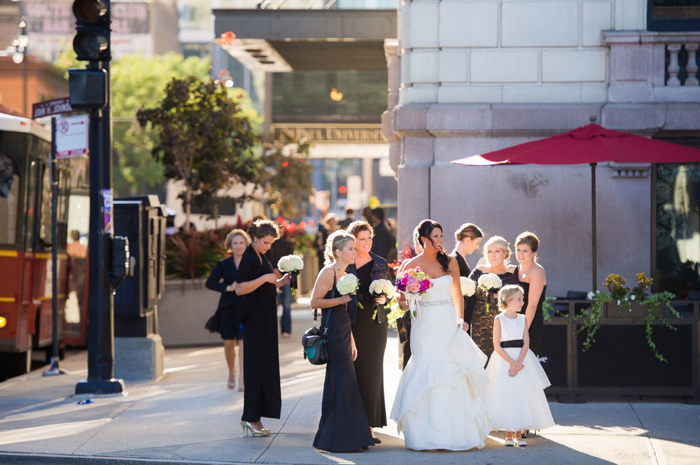 Sunlit photo of bride & bridesmaids outside the Blackstone Hotel Chicago.