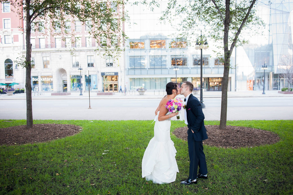 "Couple kisses during their ""first look"" at Grant Park Chicago."