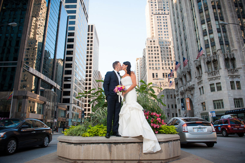 Editorial portrait of couple on median of Michigan Avenue near the Wrigley Building.