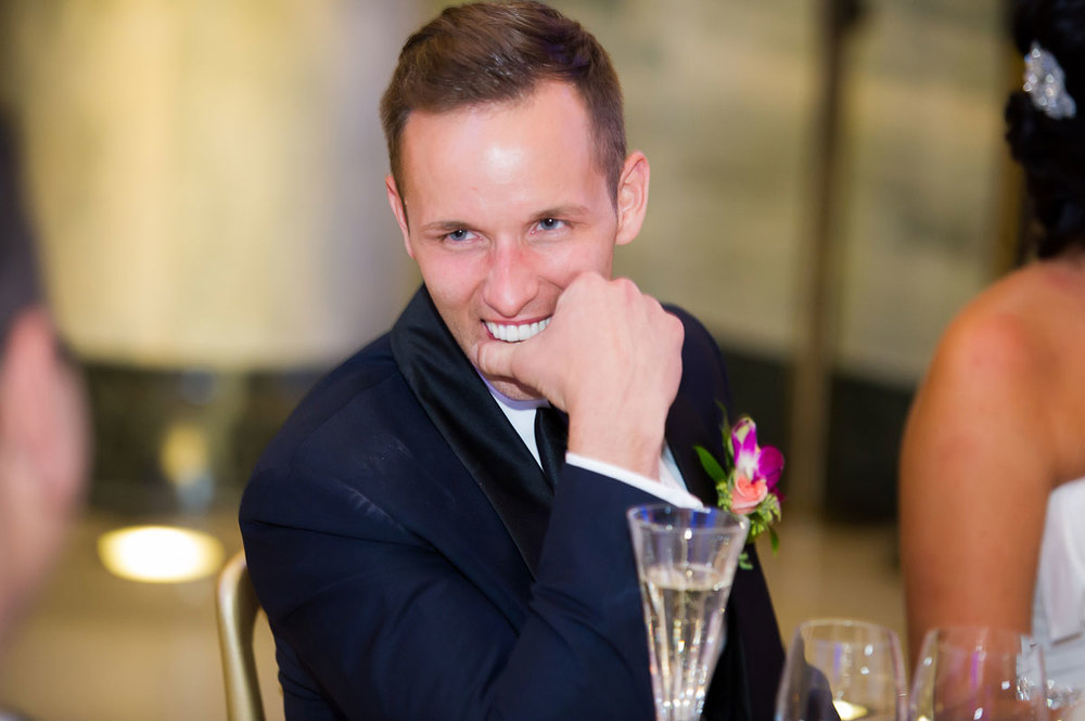 Groom laughs during the father-of-the-bride's welcome toast at the Shedd Aquarium.