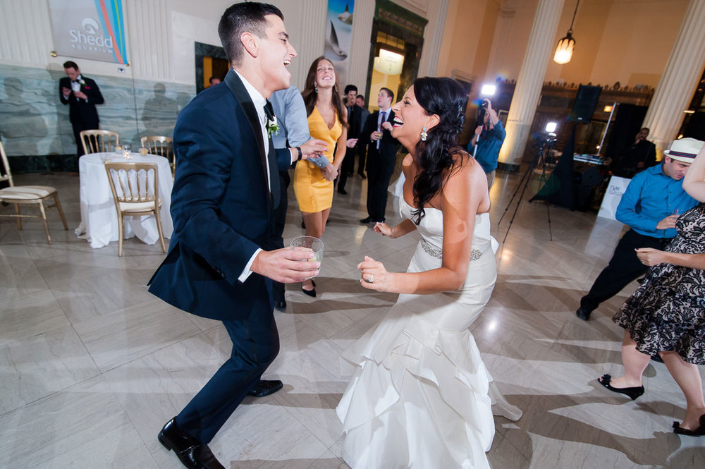 The bride and her brother dance during her wedding reception at the Shedd Aquarium.