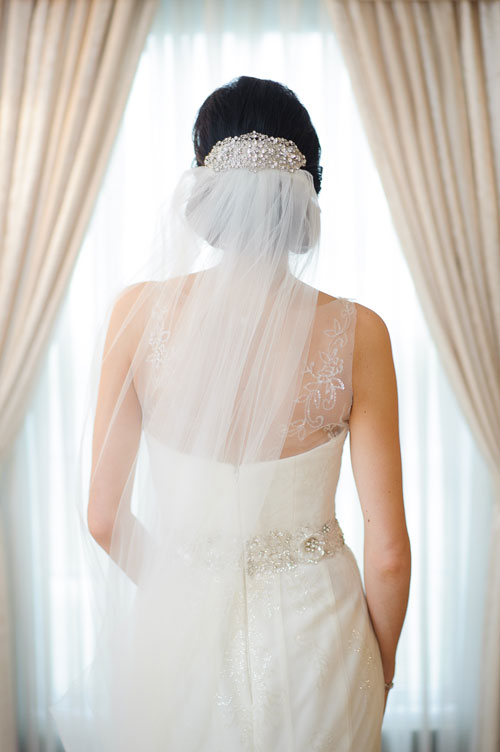 Window light portrait of the bride during her Chicago wedding.