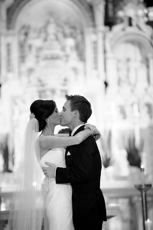 Bride & groom's first kiss during theirSt. Vincent De Paul Chicago wedding.