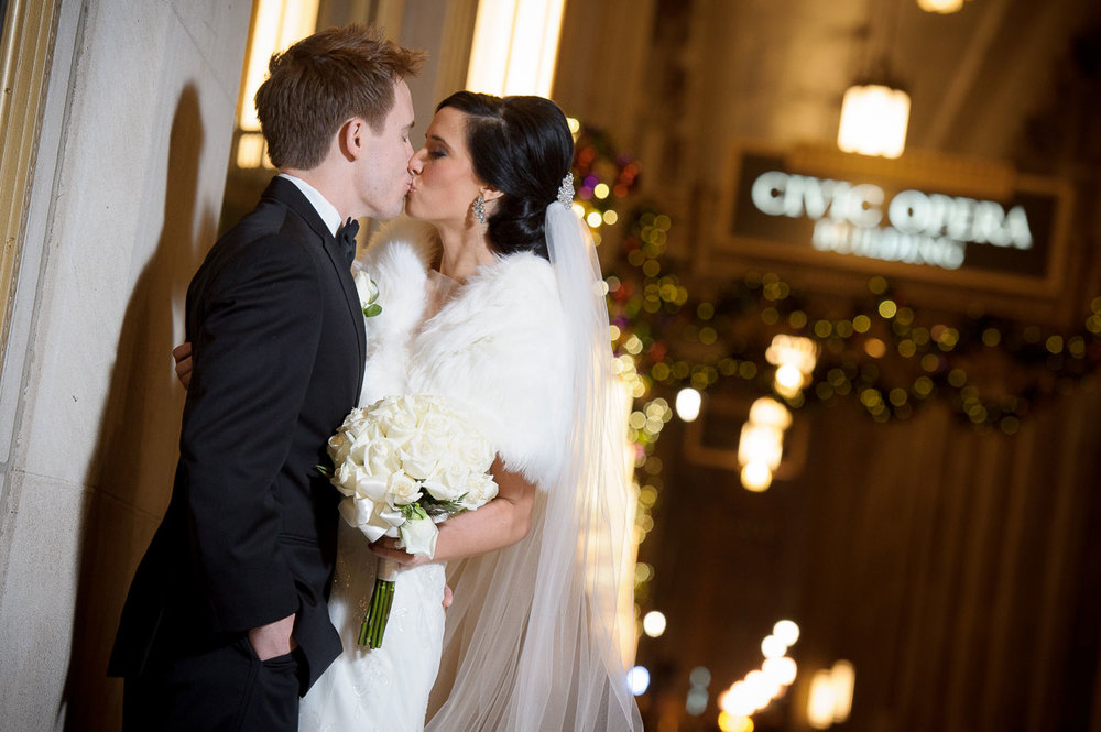 Bride & groom kiss outside the Civic Opera House Chicago.