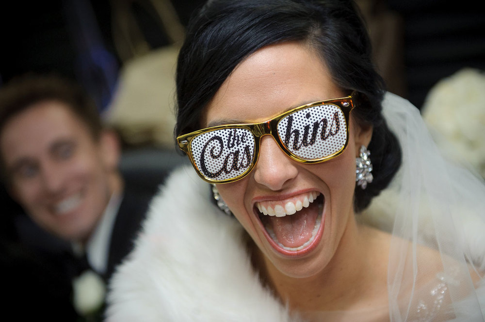 Fun wedding moment with the bride wearing custom sunglasses during her Chicago wedding.