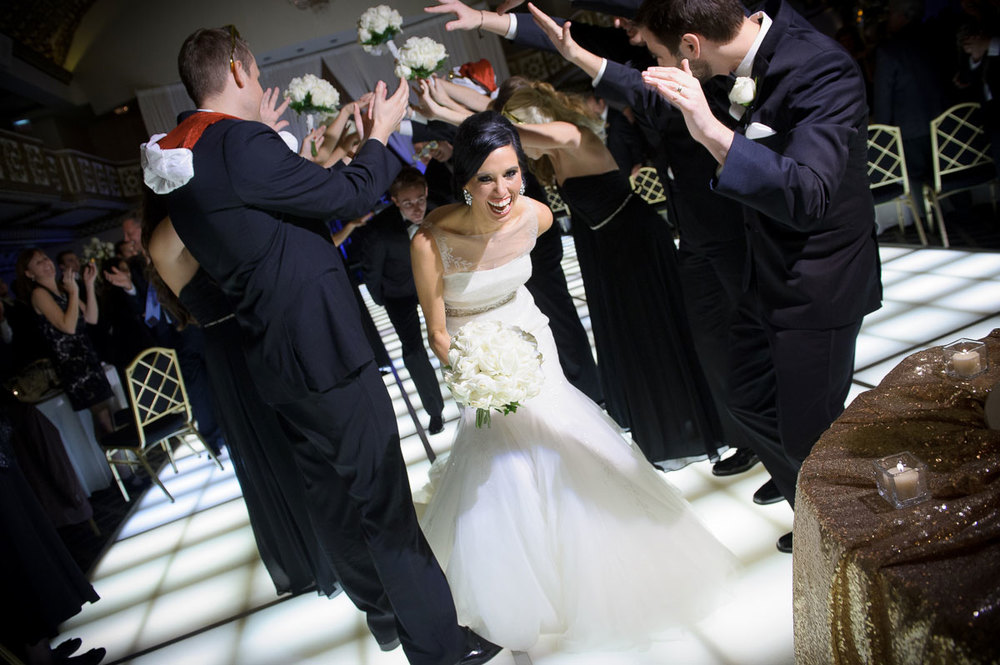 Bride & groom make an entrance during their Knickerbocker Hotel Chicago wedding.