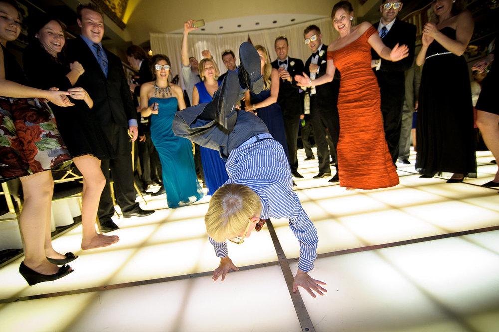 Kidbreak dancesduring a wedding at the Knickerbocker Hotel Chicago.