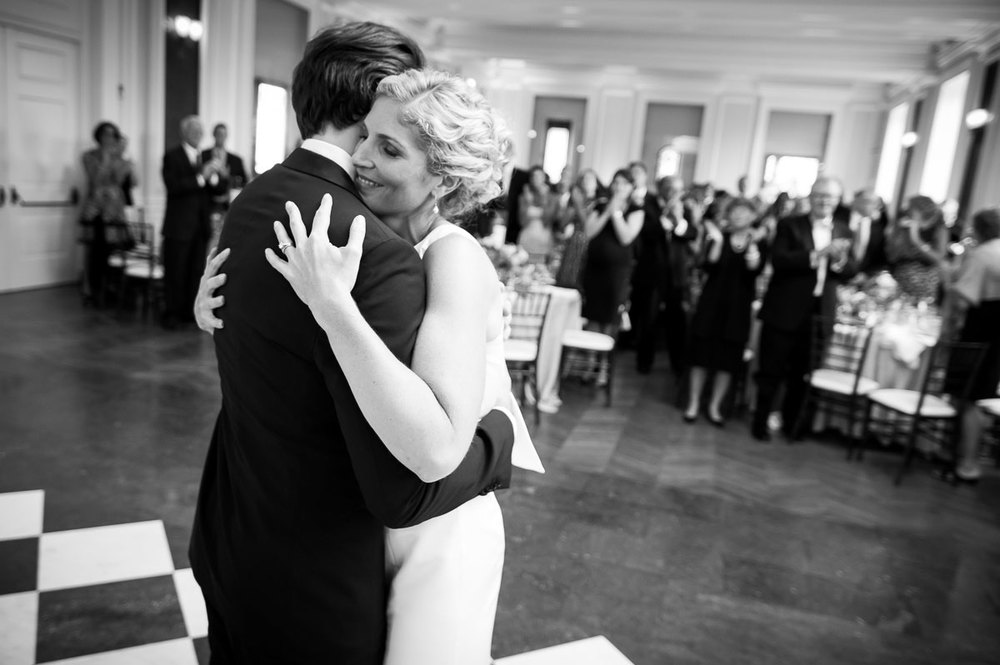 Bride & groom embrace during their first dance at a Chicago History Museum wedding reception.