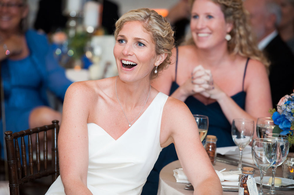 Bride reacts to her father's speech during her wedding reception at the Chicago History Museum.