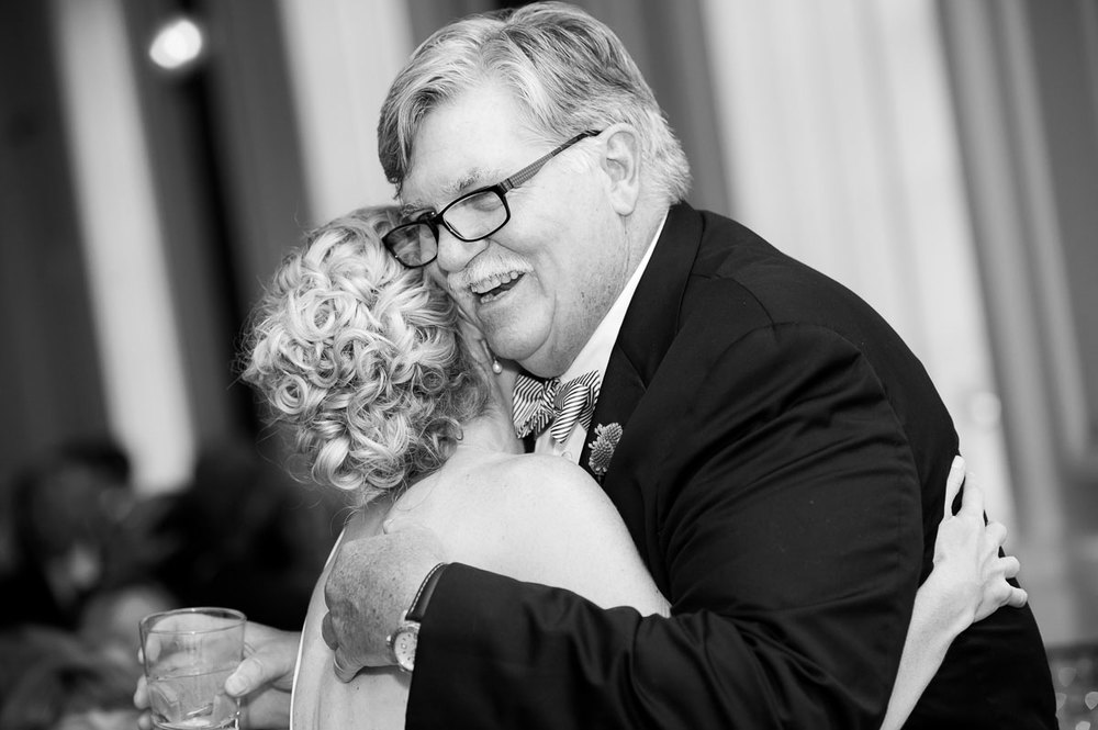 Father & daughter embrace during a wedding reception at the Chicago History Museum.