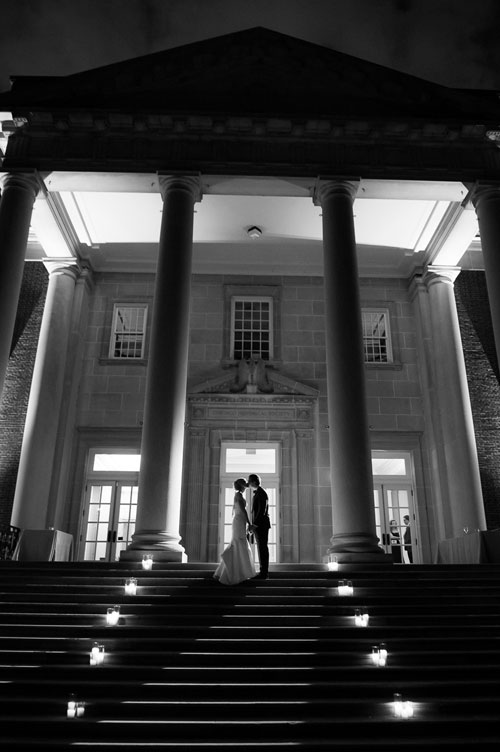 Creative night portrait of the bride & groom on the steps of the Chicago History Museum.