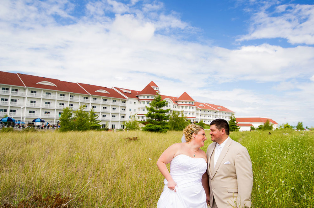 Bride & groom share a laugh on their wedding day at Blue Harbor Resort in Sheboygan, Wisconsin.