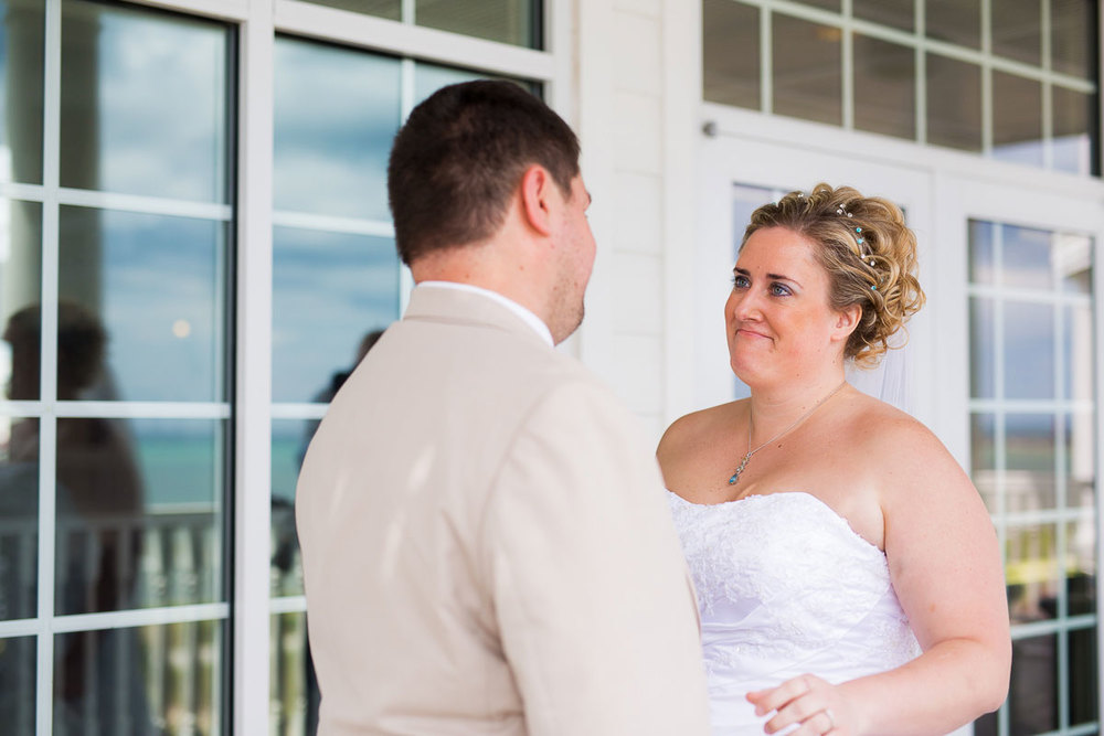 "The couple's ""first look"" on a balcony at Blue Harbor Resort in Sheboygan, Wisconsin."