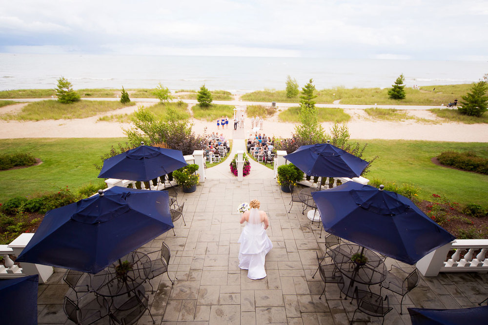 Bride walks down the aisle during her wedding at Blue Harbor Resort.