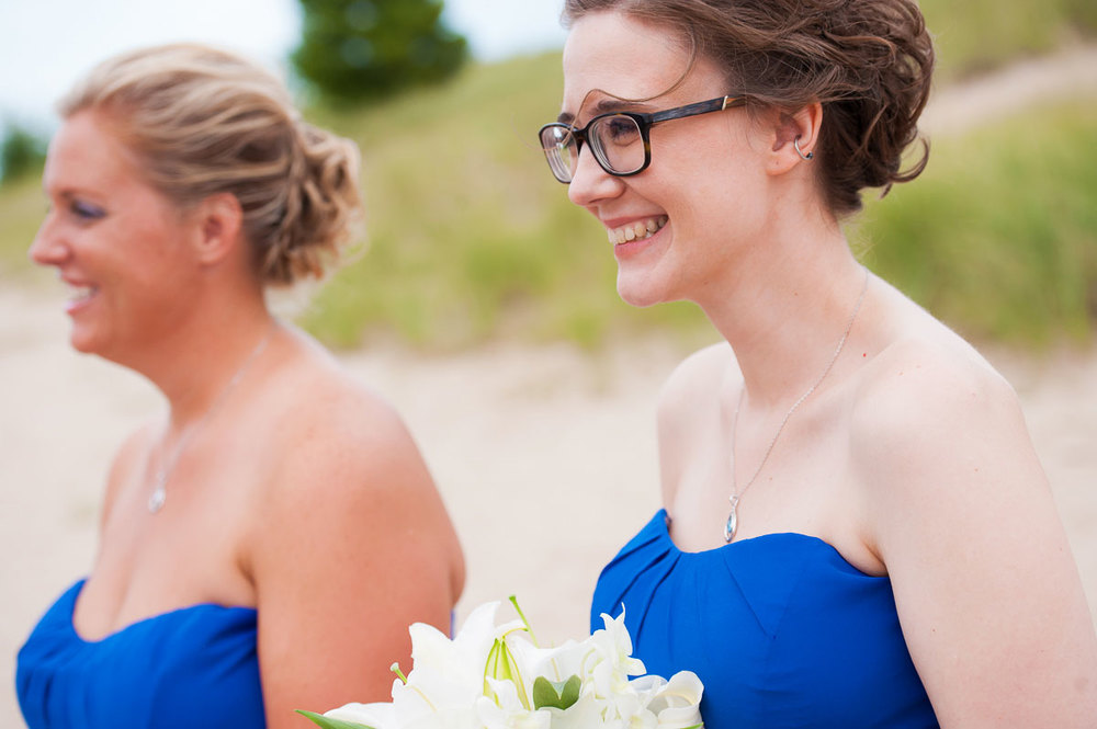 Bridesmaids smile during a wedding ceremony at Blue Harbor Resort in Sheboygan, Wisconsin.