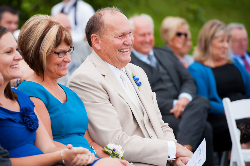 Father-of-the-bride smiles during his daughter's wedding at Blue Harbor Resort.