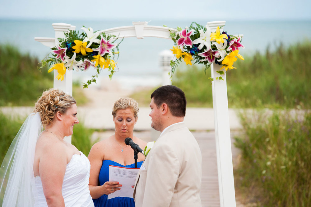 The maid-of-honor says some words of encouragement during a wedding ceremony at Blue Harbor Resort.
